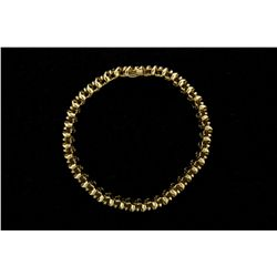 BRACELET: Ladys 14ky domed ''S'' link diamond line bracelet; 40 rb dias, 2.9mm to 3.1mm = est 4.00ct