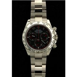 ROLEX: Mens 18kw Rolex O.P. Daytona Cosmograph wristwatch; black dial w/ silver Arabic index, red ch