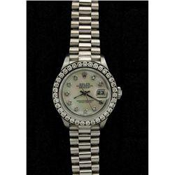 ROLEX: Ladys st.steel Rolex O.P. Date wristwatch w/ aftmkt diamond apptmnts & 18kw bracelet; mother-