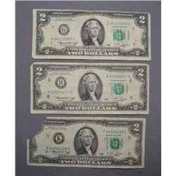 THREE TWO DOLLAR BILLS