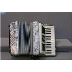 A vintage small Frontalini accordion