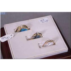 Three ladies rings including 10kt yellow gold ring set with small diamond, 14kt gold ring set with t