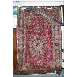 An Iranian Trabriz area rug with center medallion, busy overall floral including pots, wide border i