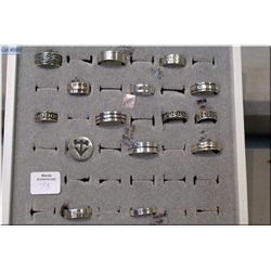 A selection of brand new sterling silver rings in a retail ring display