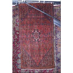 An Iranian Mir wool area rug with center medallion and delicate overall geometric pattern in shades