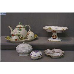 A selection of porcelain collectibles including Hammersley comport, Franz tea set and fruit motif di