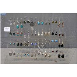 A large selection of brand new sterling silver and gemstone earrings with rack, 32 pieces