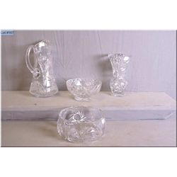 A selection of pinwheel crystal including fruit bowl, pitcher, flower vase and footed dish