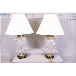 A pair of crystal table lamps on wooden bases