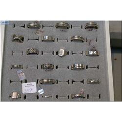 A selection of brand new sterling silver ring in a retail ring display