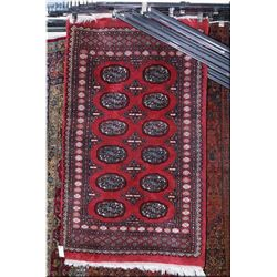 """A small wool area rug with geometric pattern 36"""" X 63"""""""
