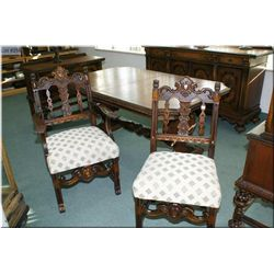 An early mid 20th century walnut table with matching armchair and side chair, made Berkey and Gay Fu