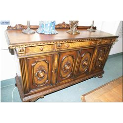 A four drawer, three door sideboard with fitted interior to match lot 256 and 257