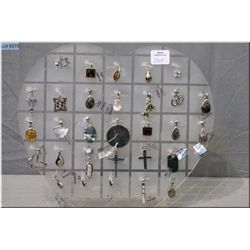 Brand new sterling silver pendants on a pendant rack including some set with gemstones, 30+ pieces