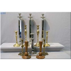 A selection of vintage candlesticks including brass, turned wood, chrome etc.
