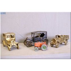 A selection of cars including vintage cast and two brass and a small cast tractor