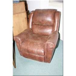 A modern simulated leather overstuff recliner