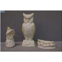Three pieces of Belleek pottery including owl figure, angelic pitcher and a row boat