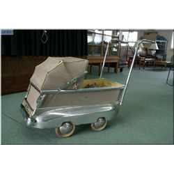 A vintage Belgian made Flandria automobile style perambulator circa 1930, with appraisal dated 2012