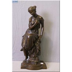 "A cast bronze statue of a Grecian woman reclining on a column, 18"" in height, no signature seen"