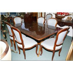 A Regency style double pedestal dining table with two insert leaves, plus eight complimenting uphols