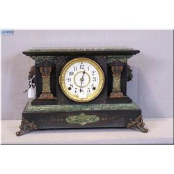 A vintage Seth Thomas chiming mantle clock with double lion head decorated case. Working at time of