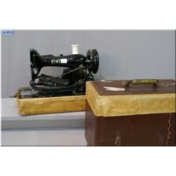 A vintage Singer 99K portable sewing machine in case