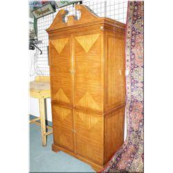 A large modern four door entertainment unit/wardrobe