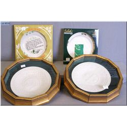 Four collectible Belleek china plates including two in gilt wall mount plate frames