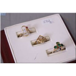 Three ladies rings including 10kt ring set with five stones, 10kt ring set with single 0.02 ct diamo