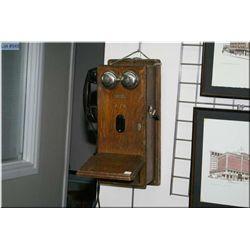A quarter cut oak Northern Electric wall phone