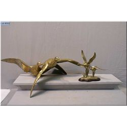 """Two brass bird sculptures including large ducks in flight 30"""" in length by 12"""" in height"""