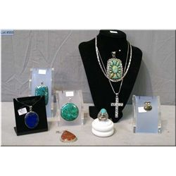 A selection of sterling silver and brand new gemstone jewellery including pendants,  necklaces and r