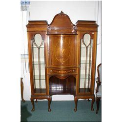 An antique Sheraton display cabinet with double glazed door, serpentine center section, extensive sa