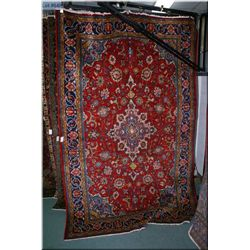 A vintage Visse area rug with large center medallion, overall floral motif in reds and soft blues 86