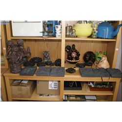 A large selection of decor items including statues, masks and wall hangings etc.