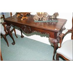 A large carved console table on ball claw supports