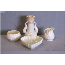 A selection of black mark Belleek pottery including nautical themed bud vase with double fish motif