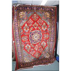 A vintage wool Handan area rug with center medallion overall potted floral motif, multiple border in