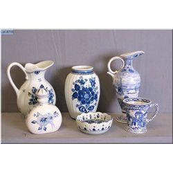 A selection of Delft pottery including handled pitchers, vase, lidded bottle etc.