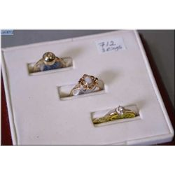 Three ladies rings including 18kt diamond cluster, 10kt and opal ring and a 10kt and solitaire diamo