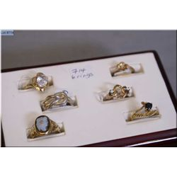 A selection of vintage rings including 10kt yellow gold ring set with cubic zirconias, sterling silv