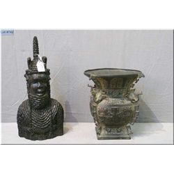 A cast Elephant head East Asian pot and a carved wooden bust