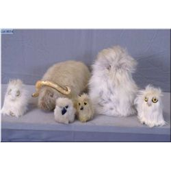 A selection of assorted handcrafted seal skin and fur animals including muskox, owl and other birds