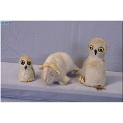 Three assorted handcrafted seal skin and fur animals including muskox and birds