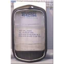 A new in box reproduction 1932 Ford car grill