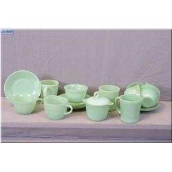 A selection of vintage Jadite including Fireking coffee cups, lidded cream and sugar and six Jadite
