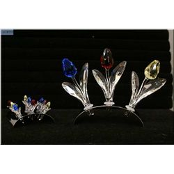 Three large Swarovski crystal tulips with tulip display and nine small Swarovksi tulips with display