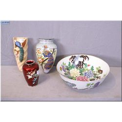 A selection of Asian collectibles including enamelled glass vase, handpainted dish, and two wall poc