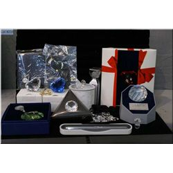 A large selection of Swarovski collectibles including large hearts, bag of small heart, paperweight,